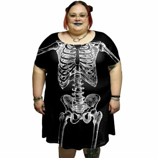 Pictured model is wearing a 5XL. This model's measurements are Bust: 55 in, Waist: 51 in, Hips: 64 in, Height: 5 ft 3 in