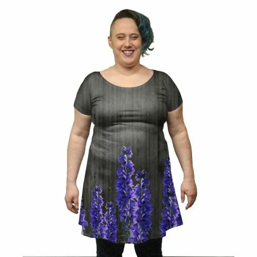 Pictured model is wearing a extra large but would prefer a 2x for fitted garments. Their measurements are Bust: 46 in, Waist: 38 in, Hips: 45 in, Height: 5 ft 5 in